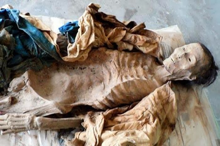 Archaeologists strip Xinjiang mummies to save ancient clothing