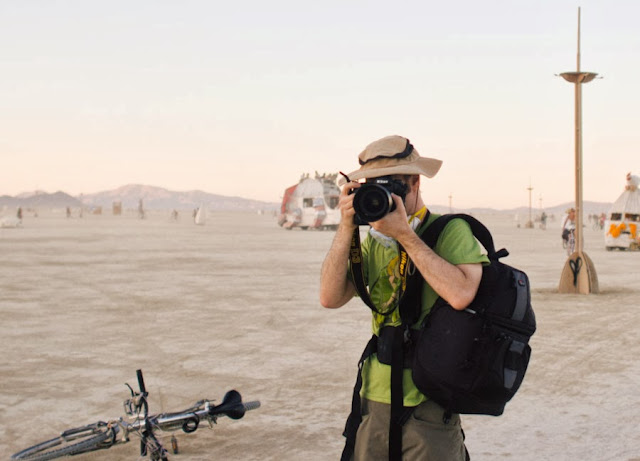 photographer making an image on the playa