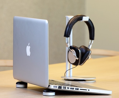 aluminum headphone stand, next to a MacBook