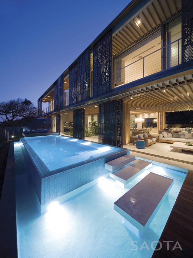 Swimming pool in African modern villa in Durban by SAOTA