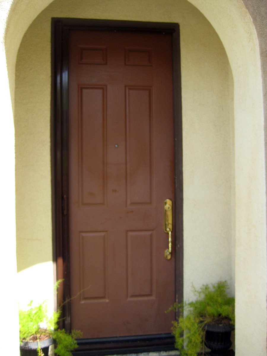 Faux wood doors love paper paint for Faux wood front doors