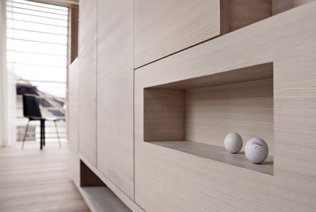Brown Wall Made from Wooden Veneer which Has Several Blocks Space Filled with Golf Balls