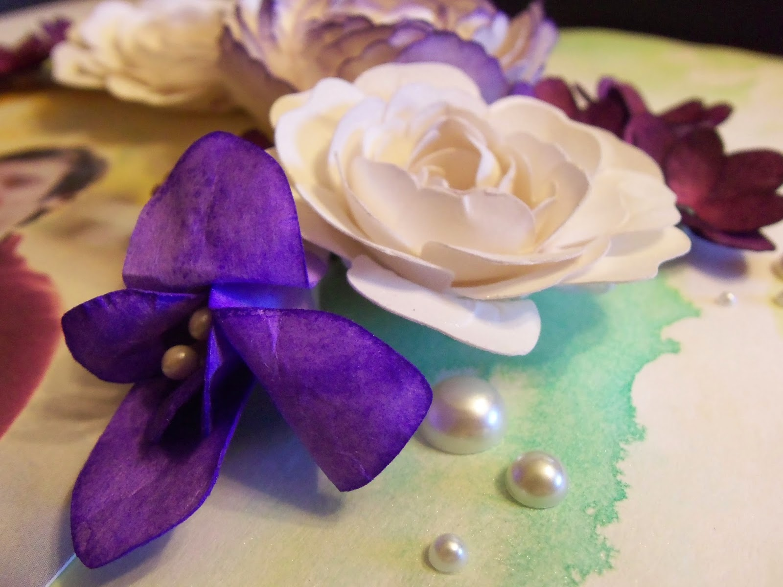 Bridal Shower Layout Gift by Alice Scraps Wonderland   Handmade flowers really add to the personalization of this scrapbook layout. The purple freesia adds a bright pop and the white roses give it class.