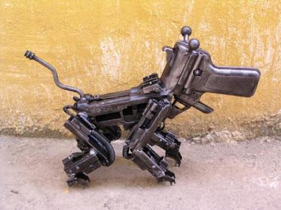 dog sculpture made out of guns