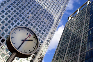 Business buildings and clock