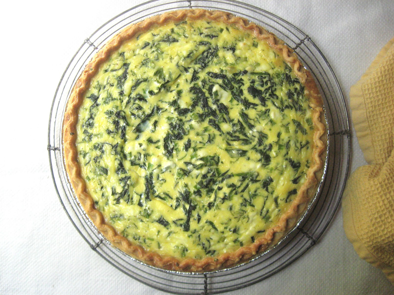she\'s in the kitchen: goat cheese and spinach quiche with fresh dill