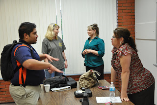 Isaacs (foreground) and Ball(background) talk to students in an SHSU Special Offenders class.