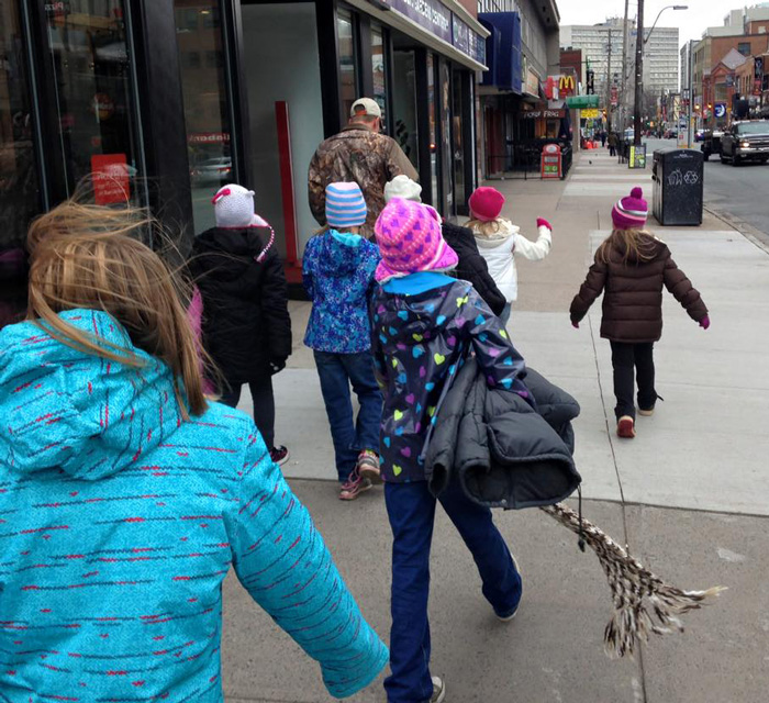 Kids Are Dressing Up Street Poles With Coats To Help The Homeless Prepare For Winter