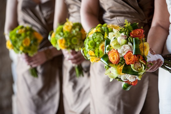 bridesmaids toupe wedding dress with bright orange, green and yellow bouquets