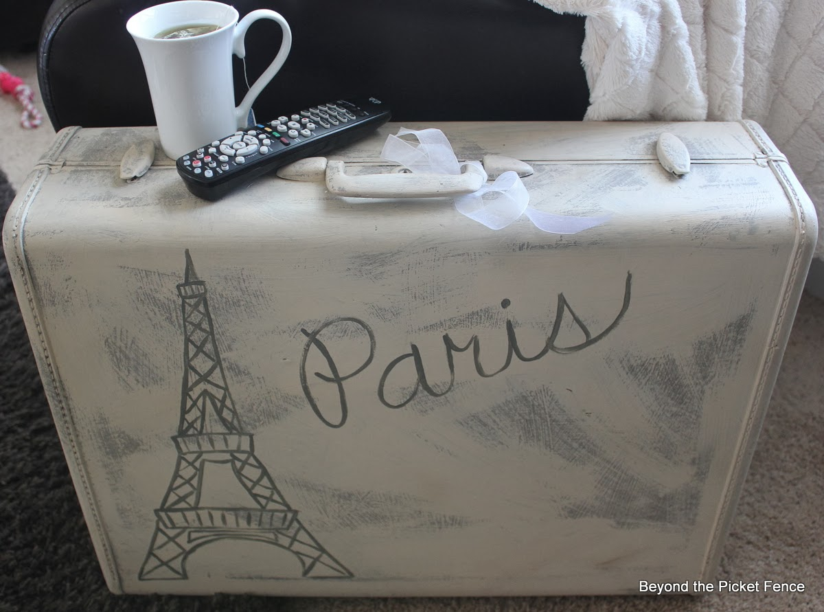Paris suitcase side table repurposed vintage suitcase http://bec4-beyondthepicketfence.blogspot.com/2014/02/paris-suitcase-side-table.html
