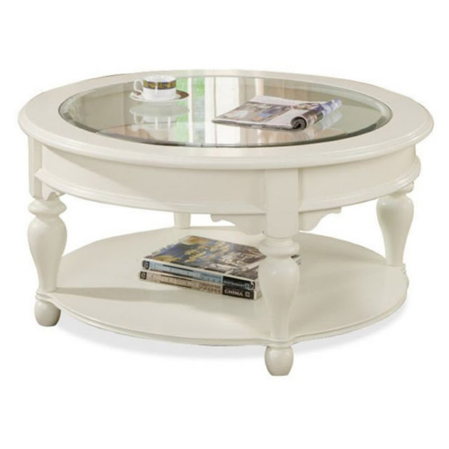 antique round wooden white coffee table with the glass of coffee and cool magazine on top also for others magazine in lower of table