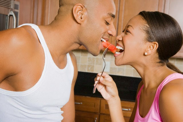 Black couple eating fruits
