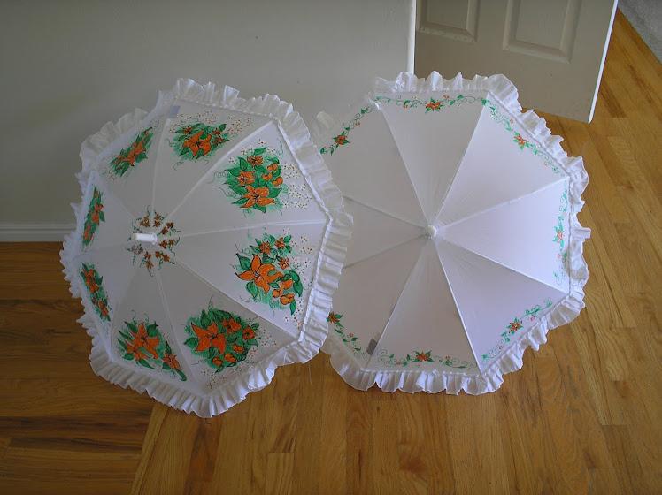 white wedding parasols orange flowers and vines