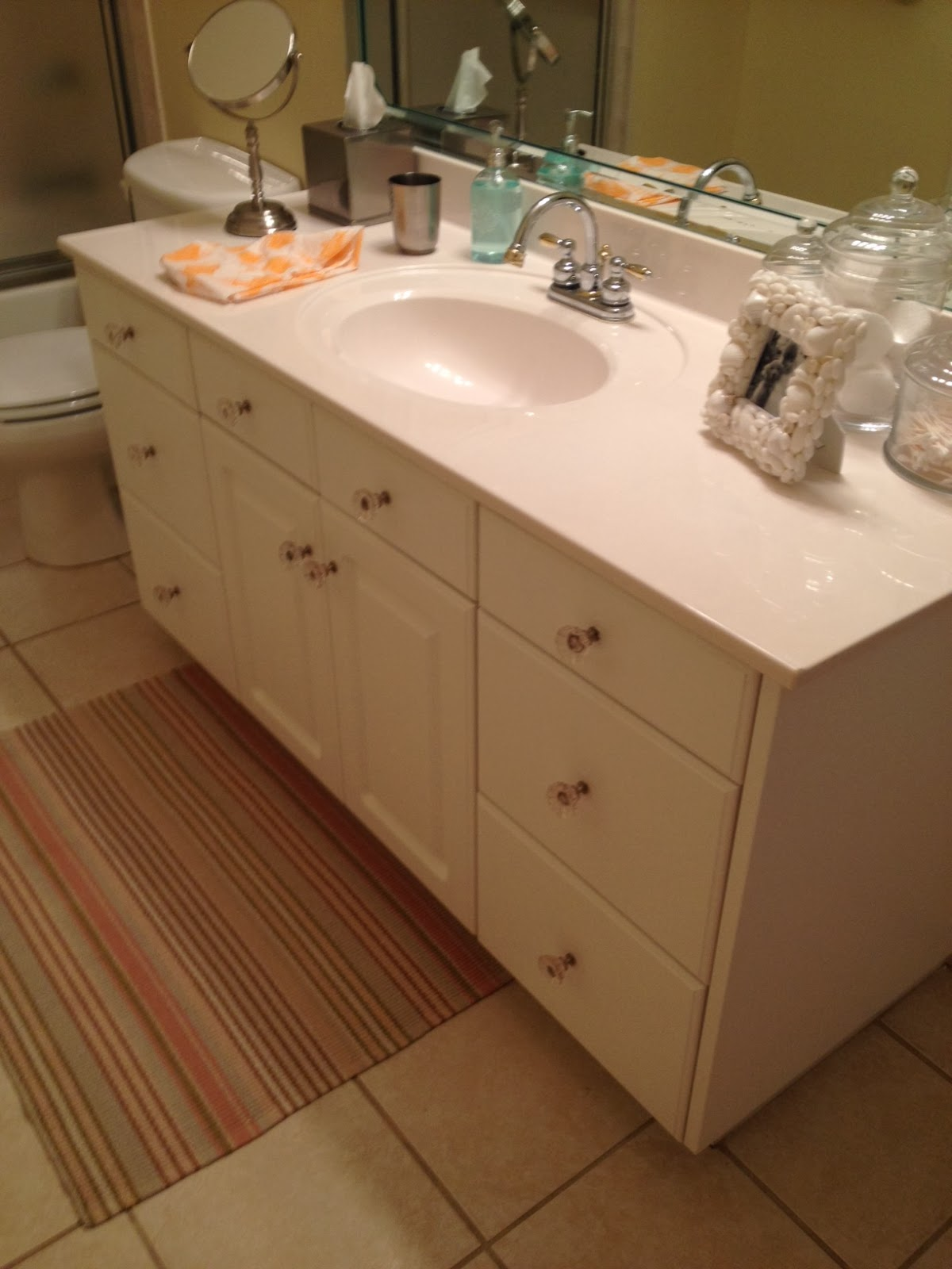 now we bleached the tile grout and changed the knobs on the cabinets
