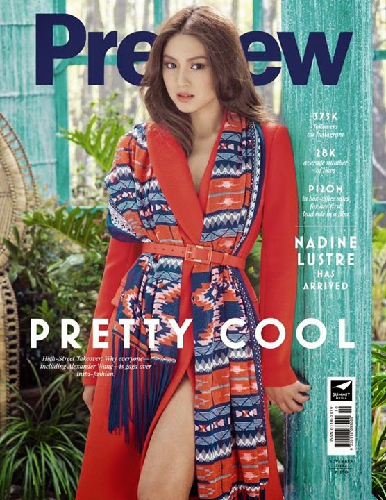 Nadine Lustre, the actress is seen wearing a red coat and a printed scarf, which are both cinched with a thin red belt.