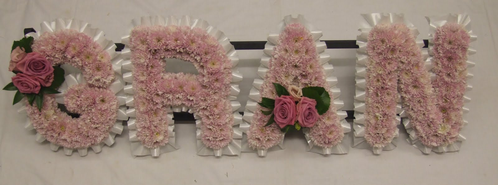 Rjs florist funeral flowers gates of heaven with a red rose spray izmirmasajfo