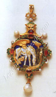 Two pendants by CARLO and ARTHUR GIULIANO: left, a gold Renaissance-style locket of Pegasus drinking at the fountain of Hippocrene (1901). The enameled locket, set with pearls, garnets and rubies, was made for Katherine Bradley to contain a miniature of Edith Cooper.