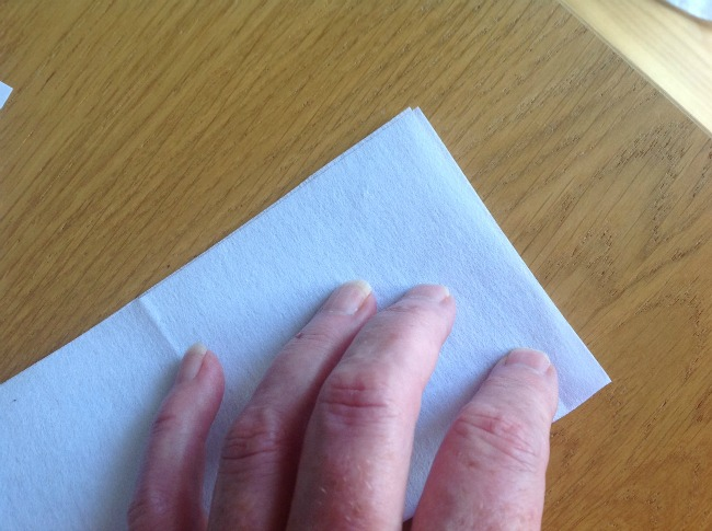 picture of a hand folding the interfacing the other way