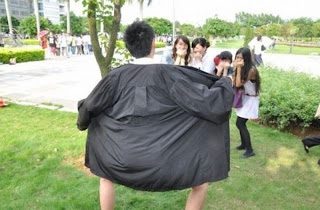 Funny picture: Chinese man doing public striptease