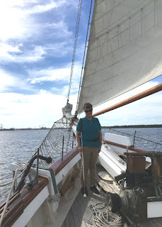 Laurel standing on the deck of the Spirit of Carolina tall ship.