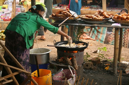 Making fried doughballs at Indein market, Burma