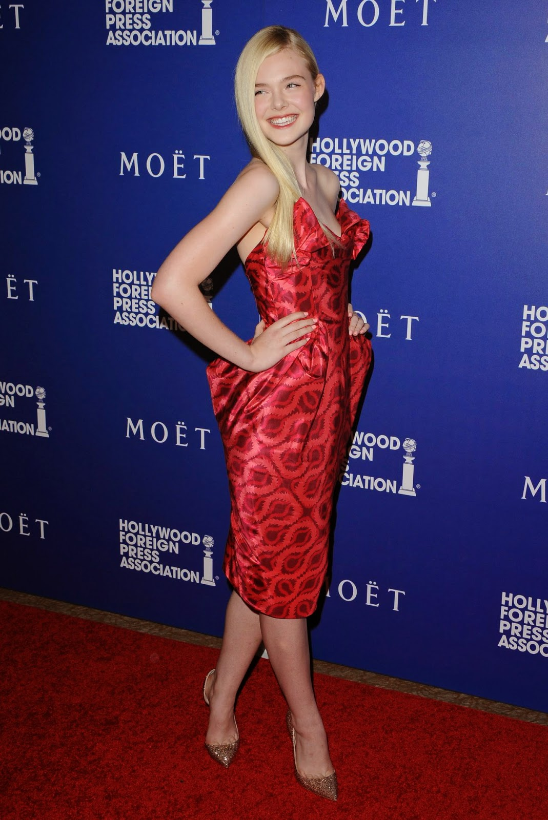 Elle Fanning is gorgeous in Vivienne Westwood at the 2014 Hollywood Foreign Press Association's Grants Banquet