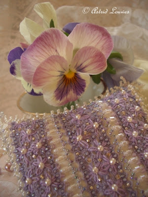 Purple little cushion with beads