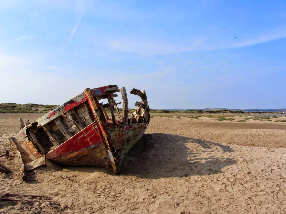 old ship wreck on the sand