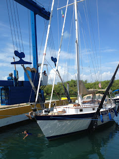 Nazario in the water after adjusting the lift straps on Whispering Jesse