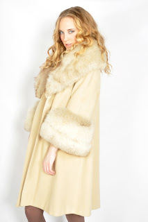 Vintage 1960's ivory colored wool swing coat with fox fur collar and cuffs.