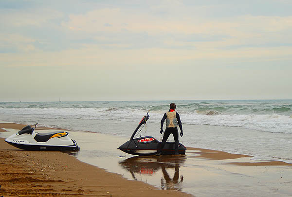 Water motorcyclist on the beach on a cloudy day