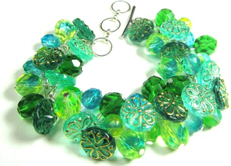 Bold bracelet has stunning green flower buttons and Fire Polished Czech Beads