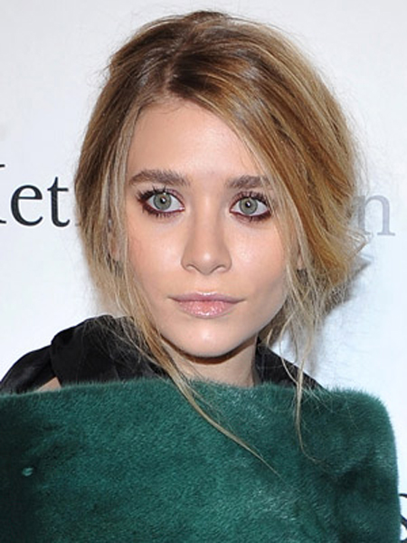Ashley Olsen pulls off casual elegance with a low chignon and soft, loose layers.