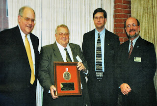 David Crews was presented the Defensor Pacem Award from the College in 2003.