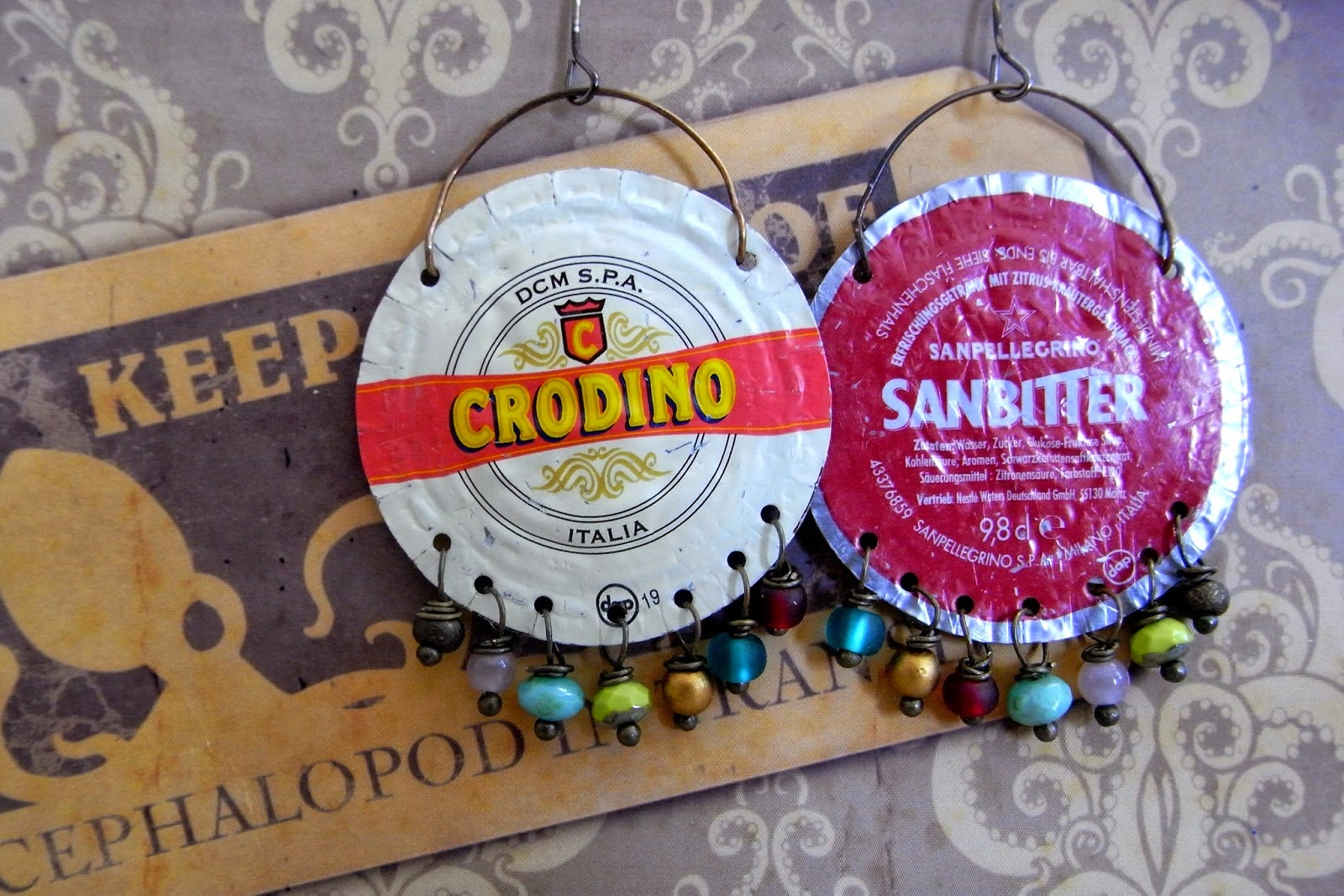 http://saraccino.blogspot.com/2014/10/tin-tales-earrings-made-from-bottle-caps.html