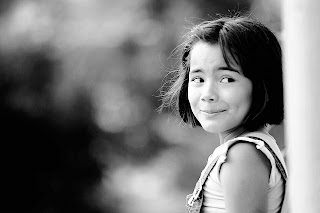 little smile - tomada de Flickr favorites de Omar D