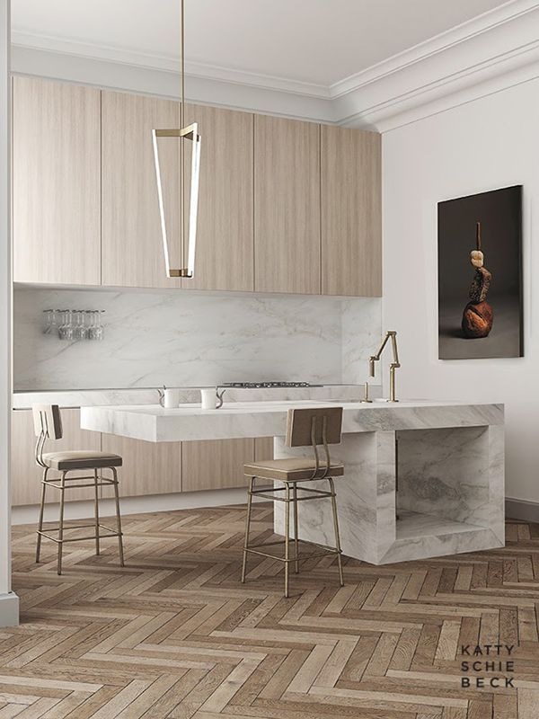 Marble kitchen counter with brass fixtures and herringbone floors