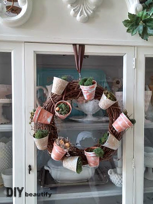 Use This Great Tip To Hang A Wreath Effortlessly From The Front Of Mirror Or