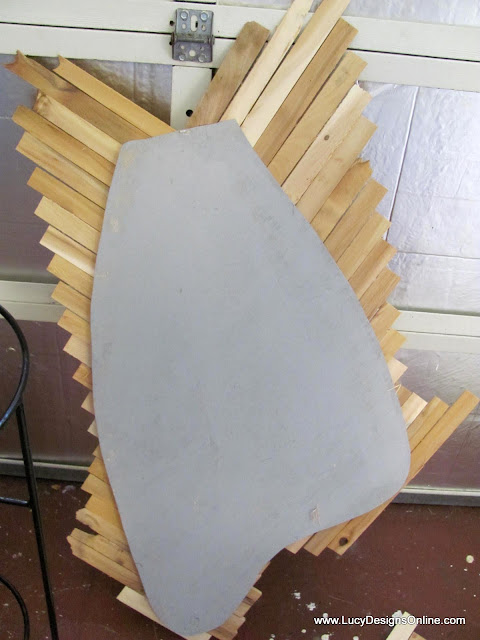 wooden shims applied to wood cut out wings