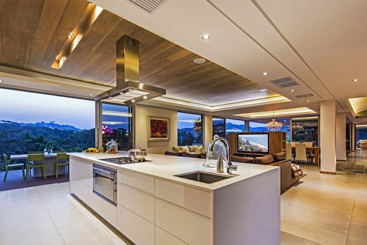 Open kitchen in Modern Mansion by Metropole Architects