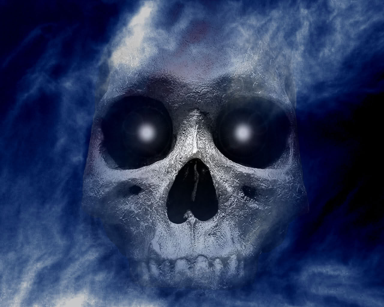 http://1.bp.blogspot.com/-676XjEl3CBo/UFx_Nu9Ma6I/AAAAAAAAAJU/DRv2B_IOJtA/s1600/halloween-skull-wallpaper.jpg