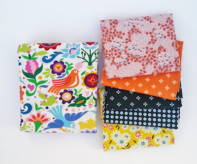 pretty fabrics featuring a scandinavian motiff and geometric patterns in pink orange navy and yellow
