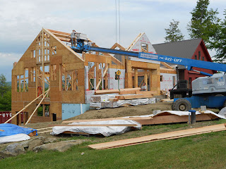 wall and roof being installed on timber frame home