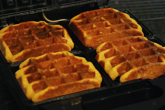 four square pumpkin waffles on open waffle iron