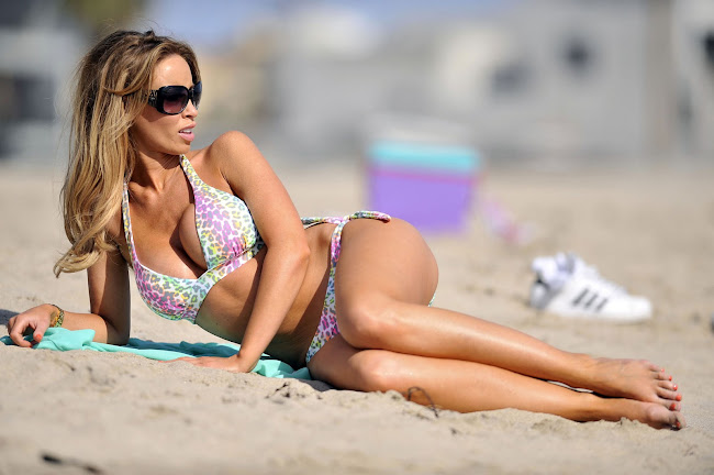 Lauren Pope relaxing on the Beach in Santa Monica wearing a bikini