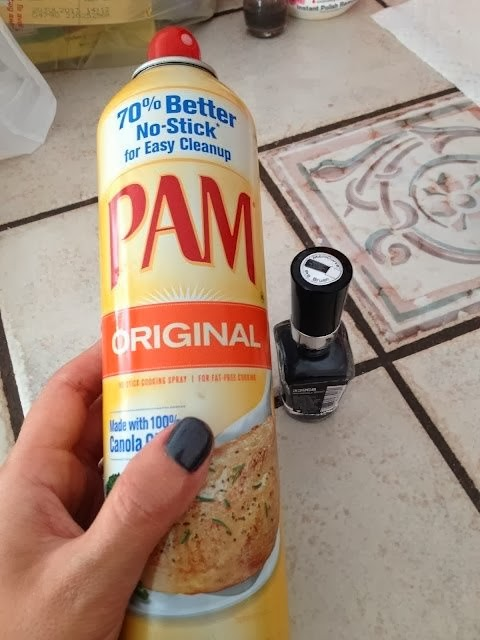 Spray PAM on wet nails, wipe it off, they're completely dry! No flippin way..