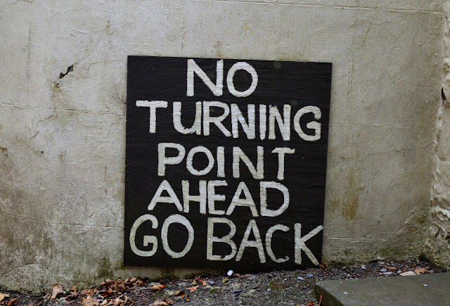 """No turning point ahead go back"" sign Laugharne"