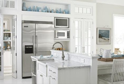 mylittlehousedesign.com blue glass collection on top of white cabinets