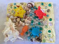 http://funprojectsforyourkids.blogspot.com/2015/05/ocean-life-sensory-bin.html