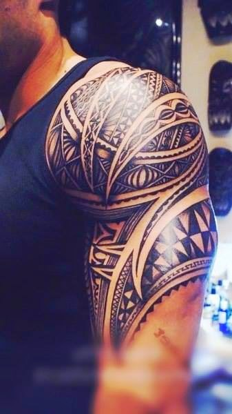 Tribal tattoo for muscular arms
